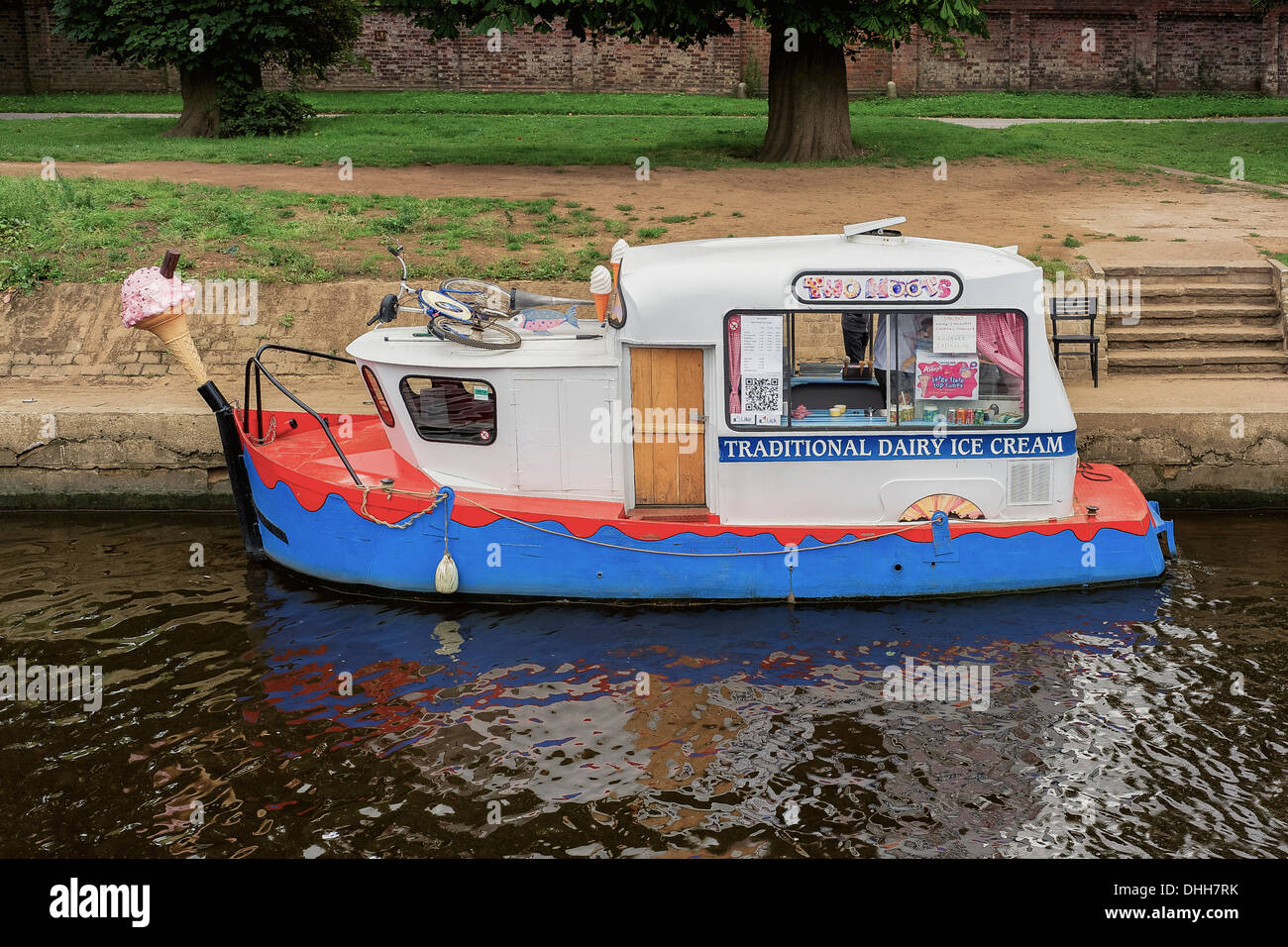 A boat converted into a floating ice cream 'van' on the River Ouse in York, UK. Entrepreneurial new business concept - Stock Image