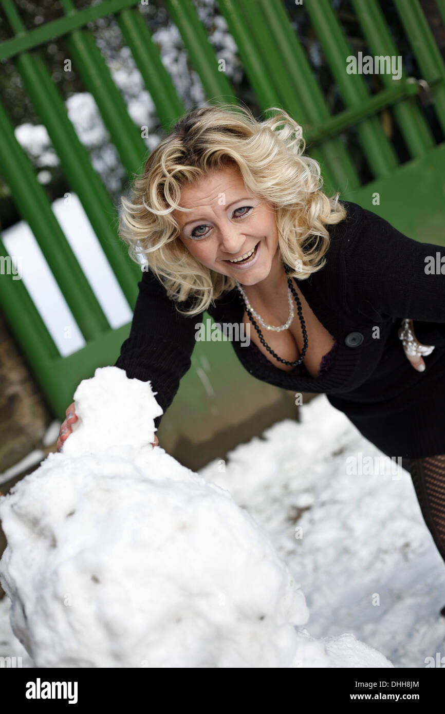 blond woman in the snow Stock Photo