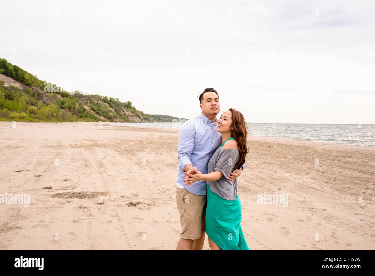 Young couple dancing on beach - Stock Image