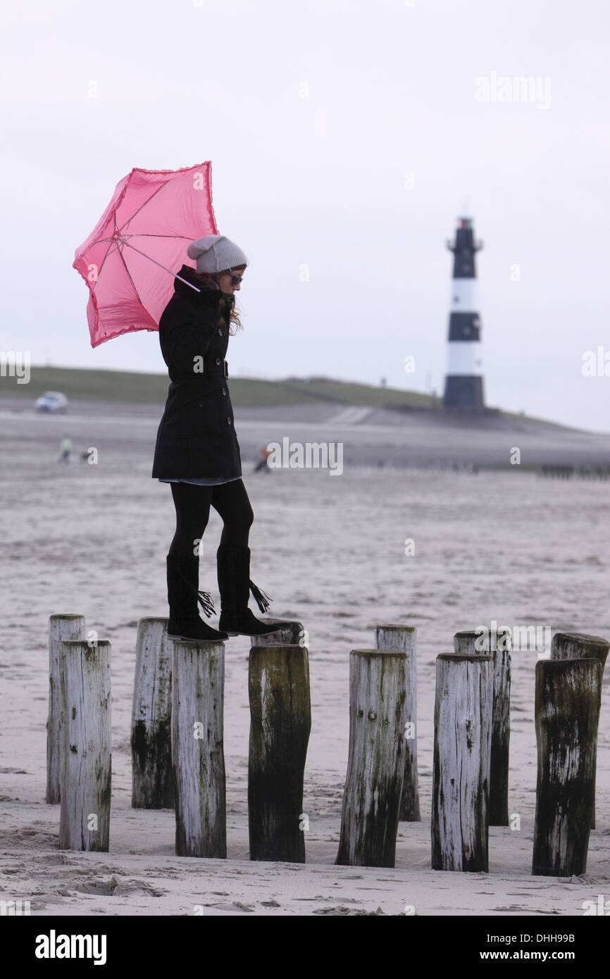 young woman with pink umbrella - Stock Image