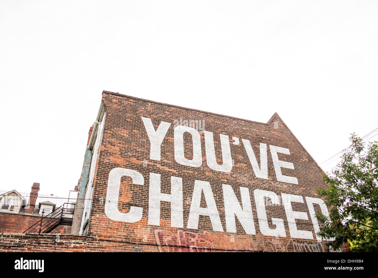 'You've changed' written on side of house - Stock Image