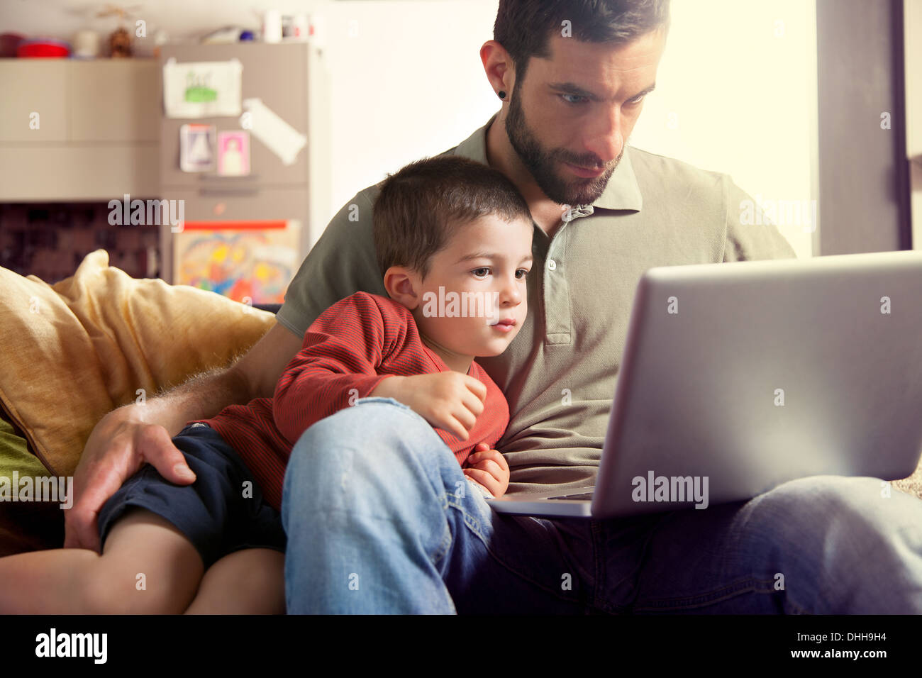 Father and son using laptop - Stock Image