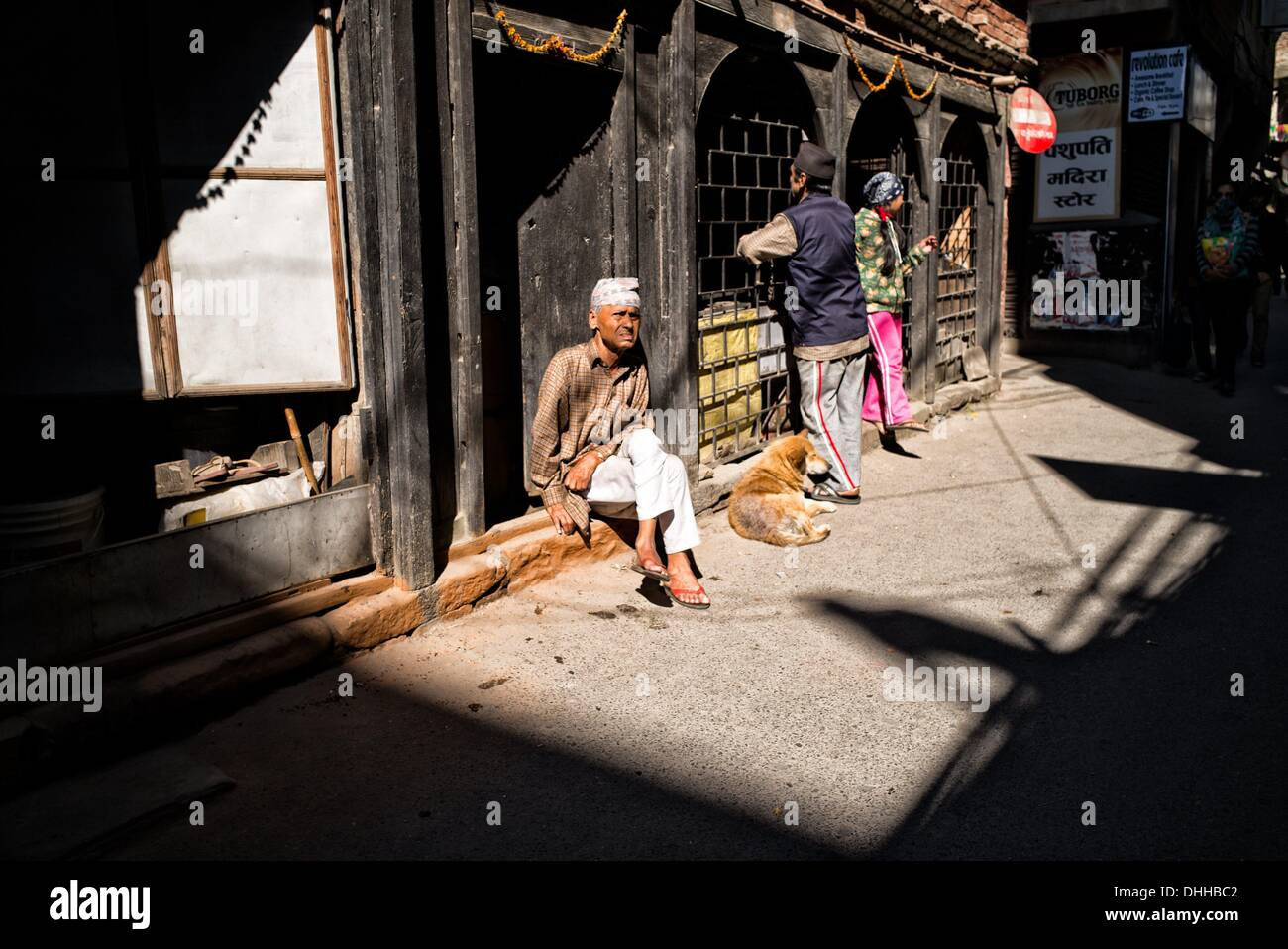 Kathmandu, Kathmandu, Nepal. 11th Nov, 2013. Elderly man sits in front of his closed shop on 11 Novemeber 2013. During general strike all shops are ordered to close.Communist Party of Nepal - Maoists (CPN-M) and their 30 parties alliance announced ten day general strike to hinder the elections as Nepal prepares to vote to elect Constitutional Assembly members. Nepal political crisis started in may 2012 when the previous constitutional assembly failed to draft the constitution. © Agron Dragaj/ZUMAPRESS.com/Alamy Live News - Stock Image