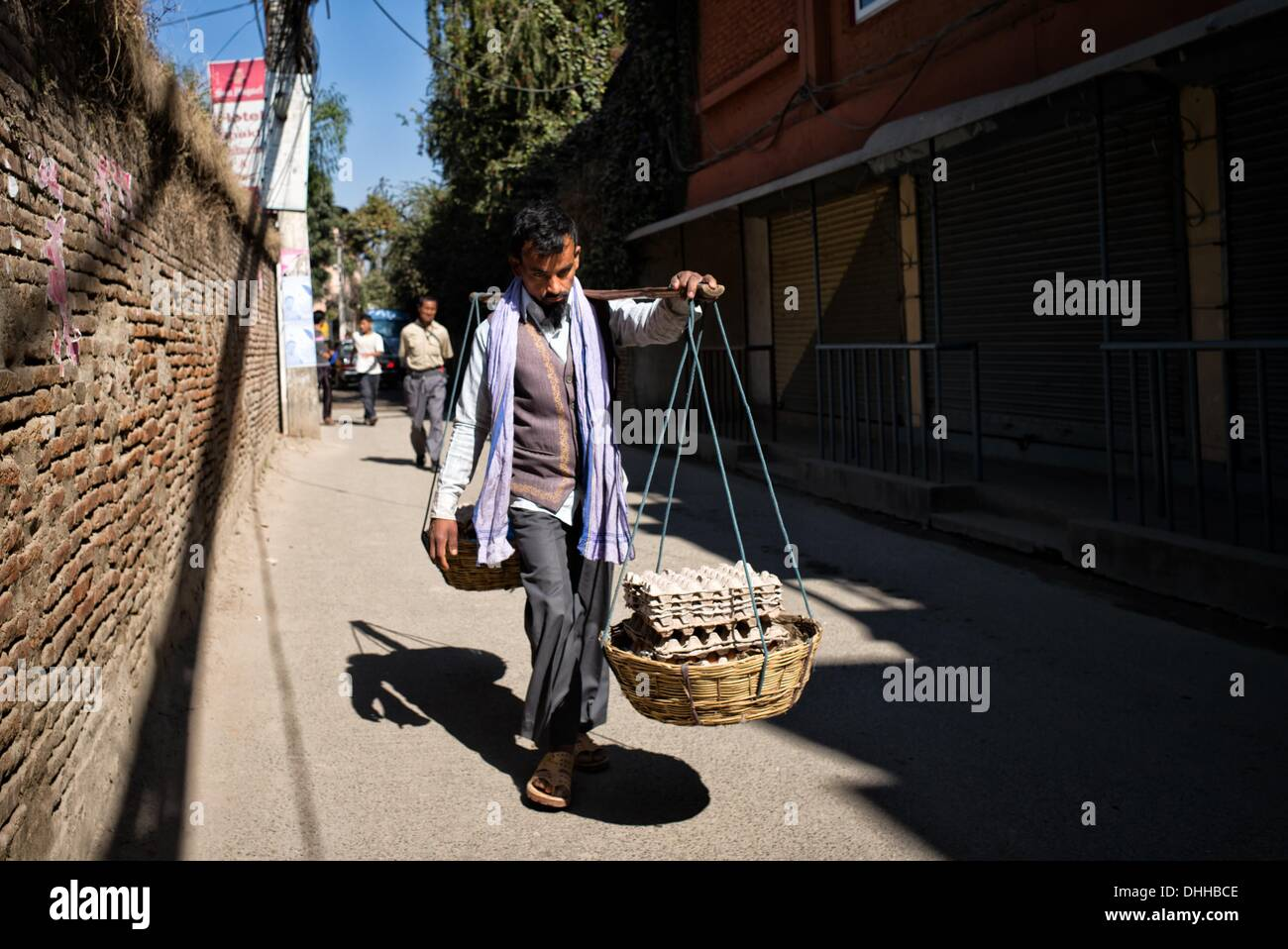 Kathmandu, Kathmandu, Nepal. 11th Nov, 2013. A hawker carries eggs for sale downtown Kathmandu. During general strike shops are ordered to close.Communist Party of Nepal - Maoists (CPN-M) and their 30 parties alliance announced ten day general strike to hinder the elections as Nepal prepares to vote to elect Constitutional Assembly members. Nepal political crisis started in may 2012 when the previous constitutional assembly failed to draft the constitution. © Agron Dragaj/ZUMAPRESS.com/Alamy Live News - Stock Image