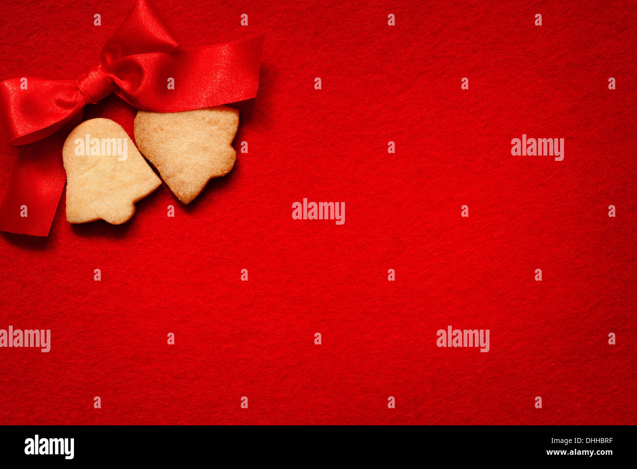 Christmas abstract background with cookies on red fabric - Stock Image