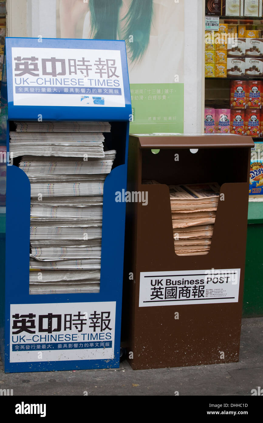 The UK Chinese Times and UK Business Post Newspaper Stand in Chinatown London - Stock Image