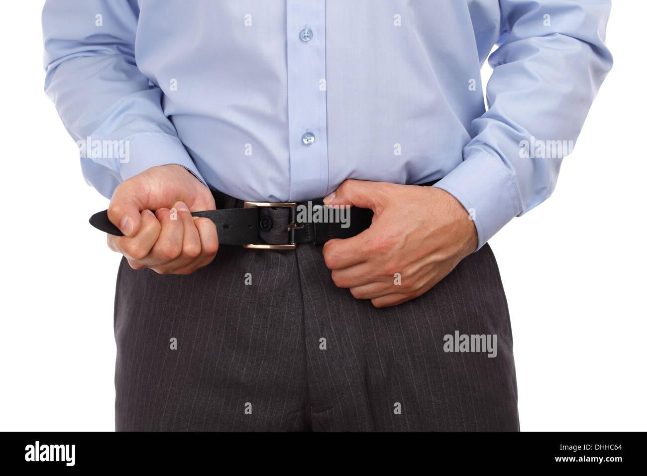 Tightening one's belt - Stock Image
