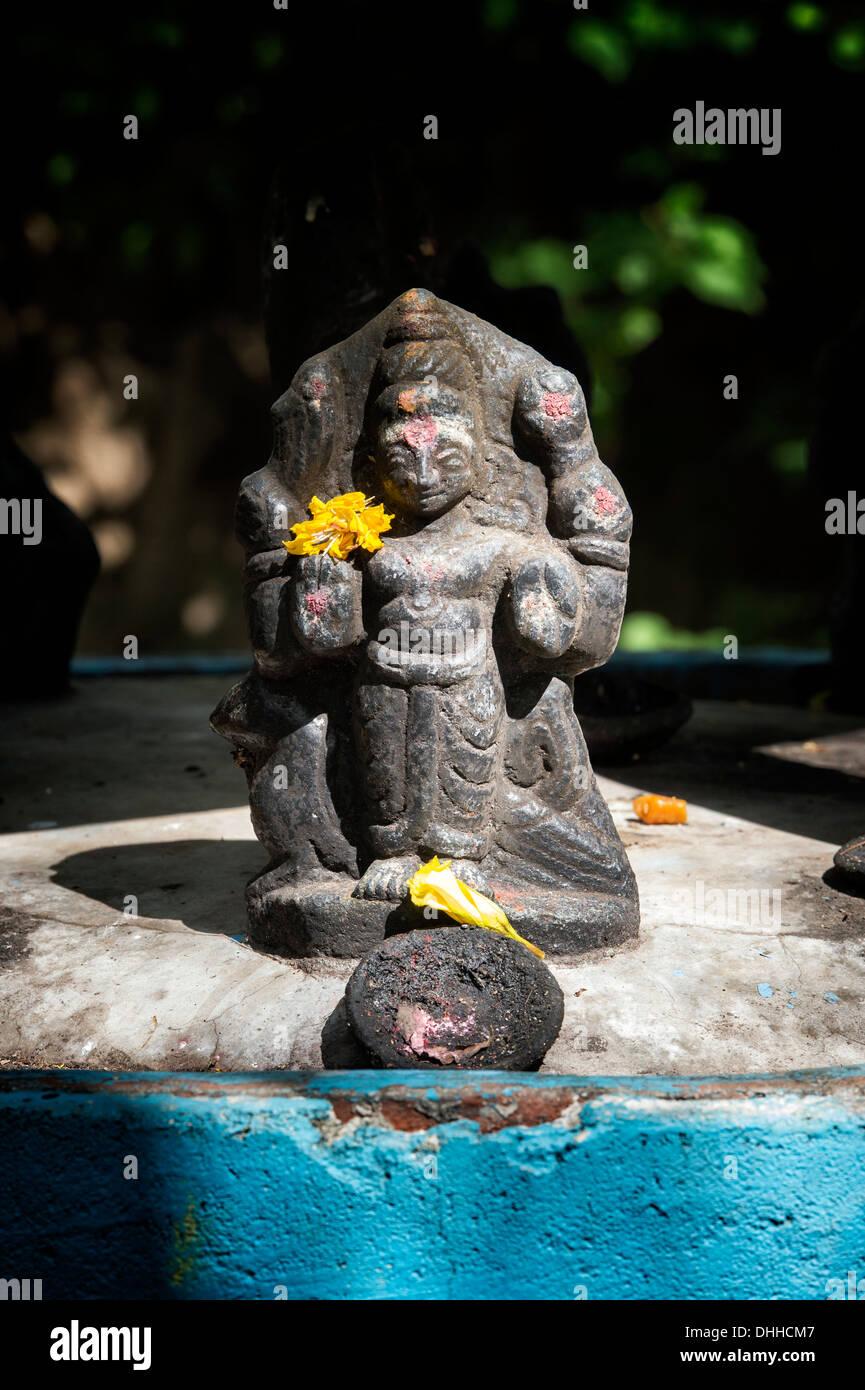 Hindu deity altar statue in a rural indian village. Andhra Pradesh, India. - Stock Image