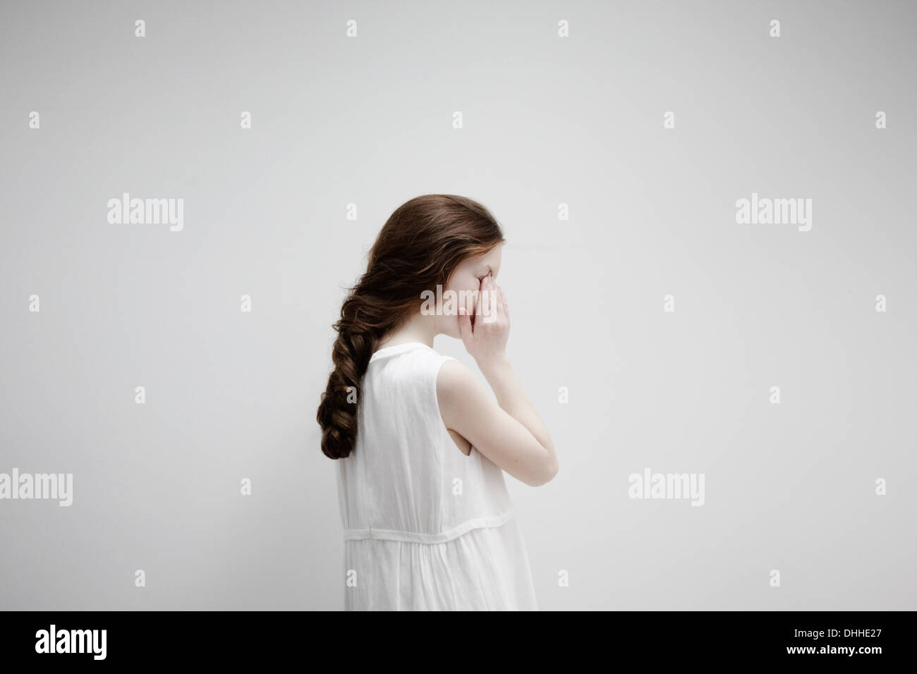 Girl posing sideways for camera - Stock Image