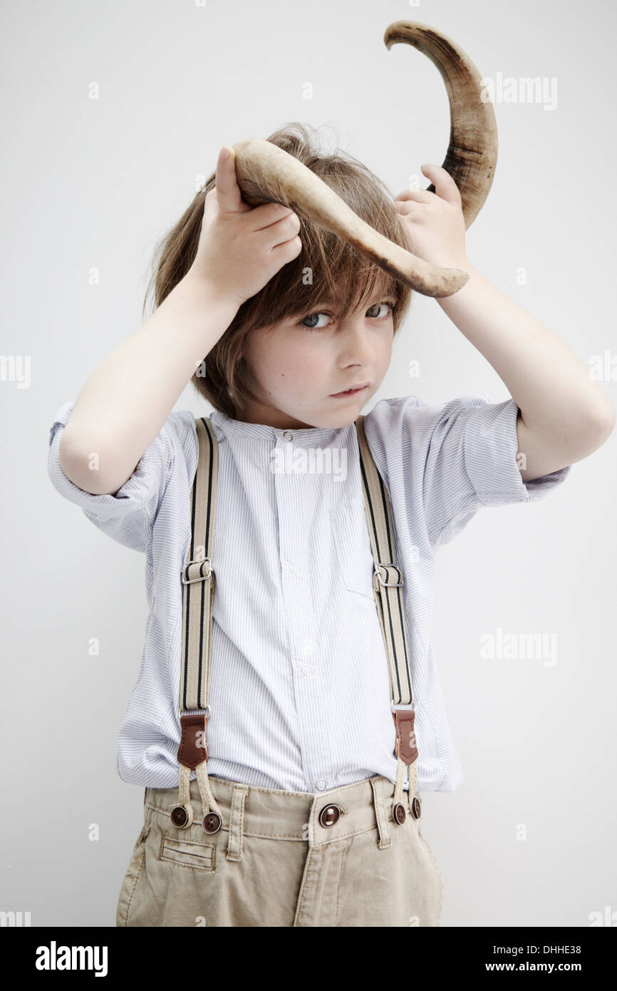 Boy posing with animal horn - Stock Image