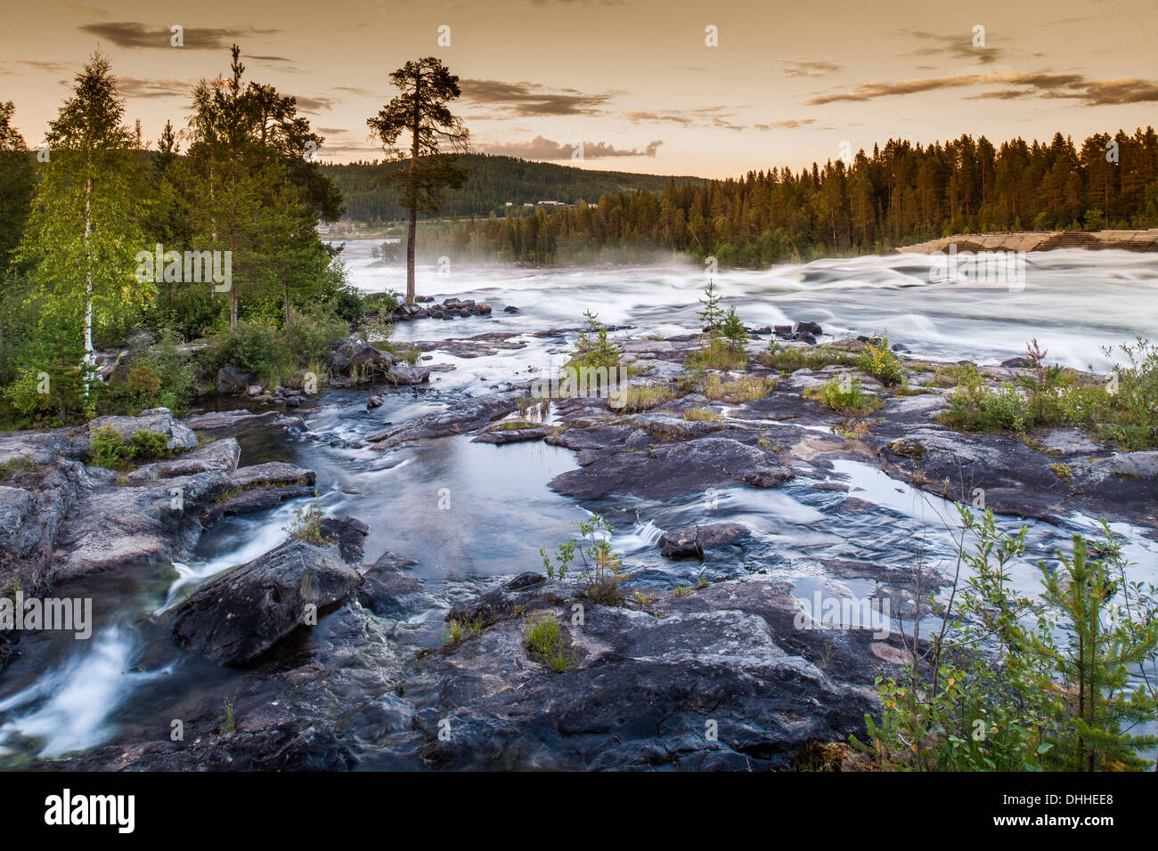 View of river flowing over rocks, Storforsen, Lapland, Sweden - Stock Image