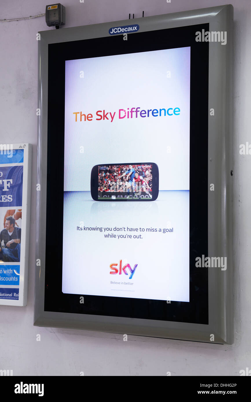 Electronic poster site at Charing Cross Station with a Sky tv advert on it - Stock Image