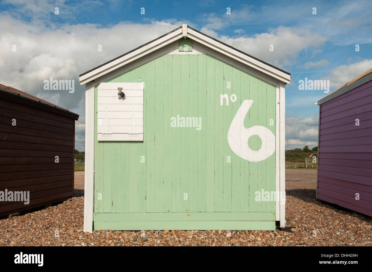 green beach hut with the number 6 - Stock Image