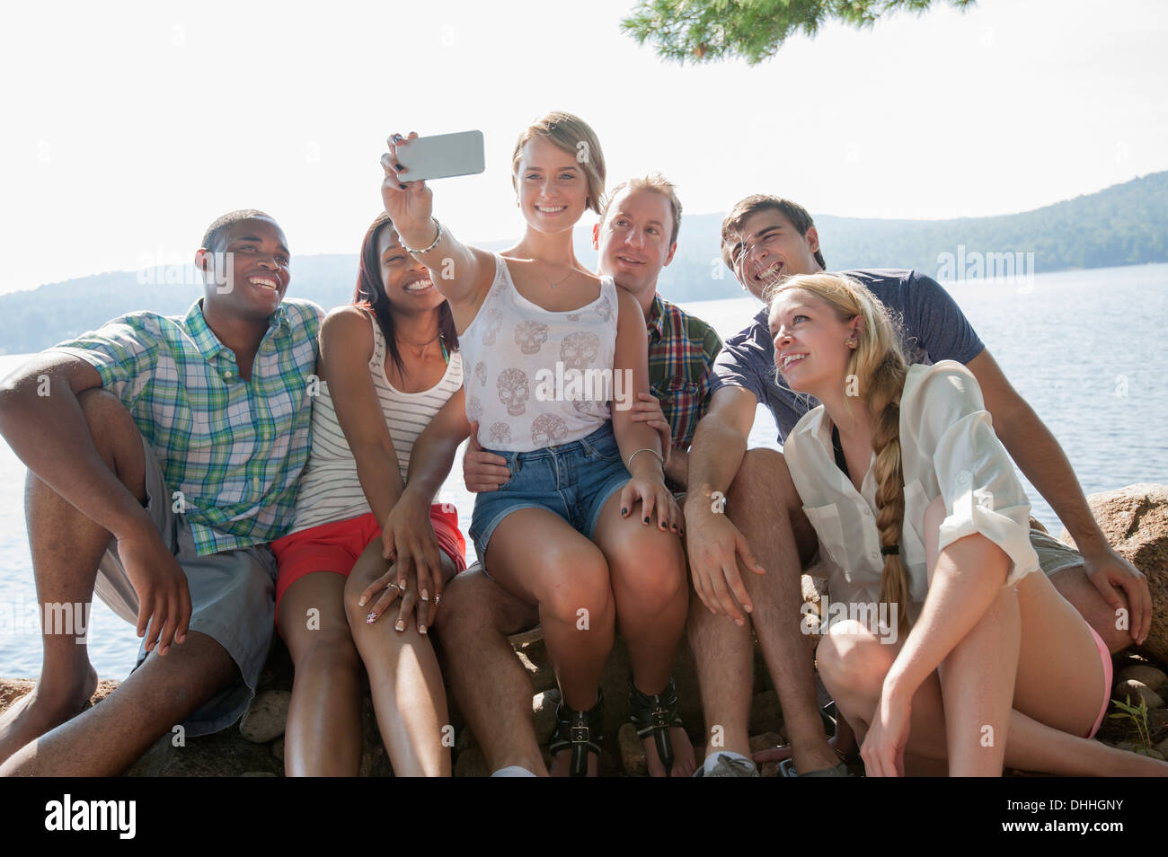 Group of friends photographing themselves - Stock Image