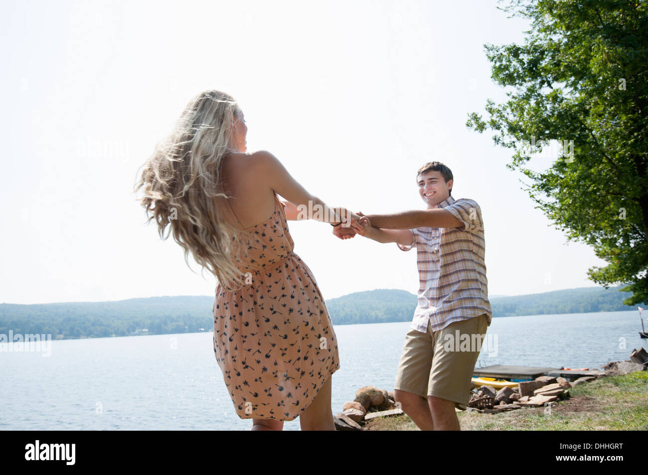 Young couple holding hands by lake Stock Photo