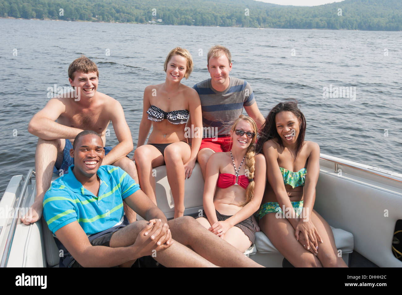 Portrait of friends in boat on vacation - Stock Image