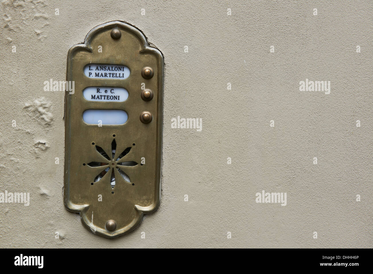 Old Fashioned Brass Door Bell Intercom On A Wall