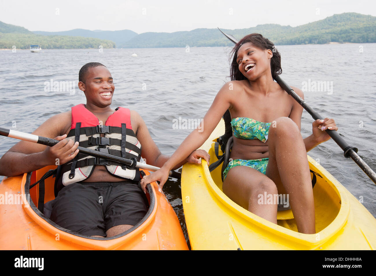 Young couple in canoes - Stock Image
