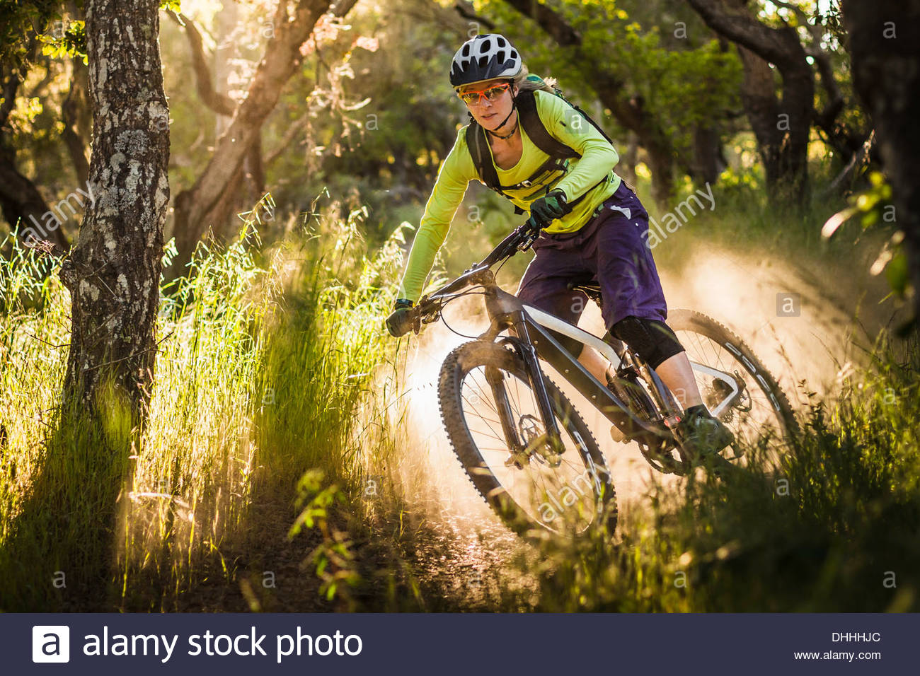 Young woman mountain biking, Monterey, California, USA - Stock Image