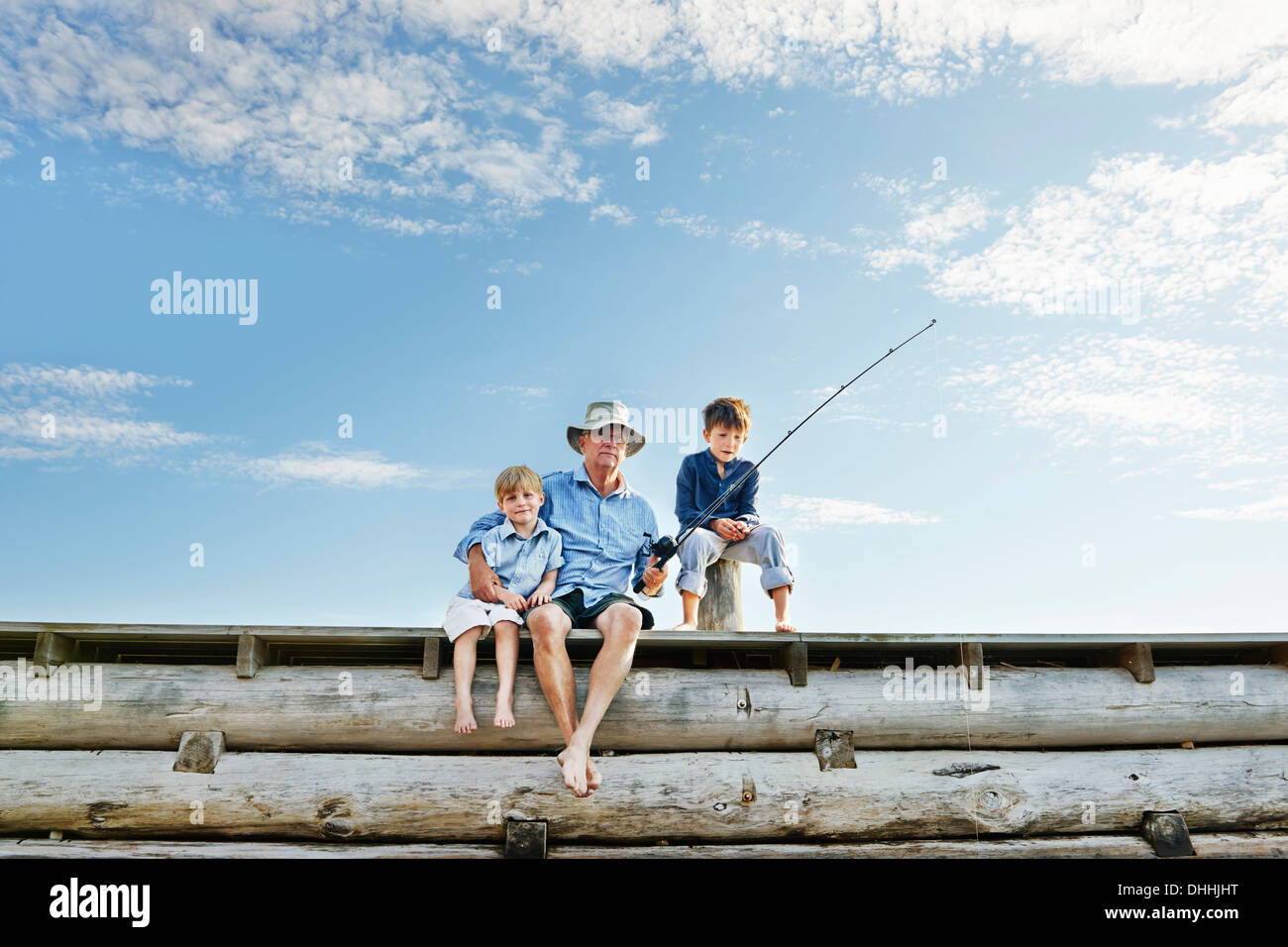 Boys with grandfather fishing, Utvalnas, Sweden - Stock Image