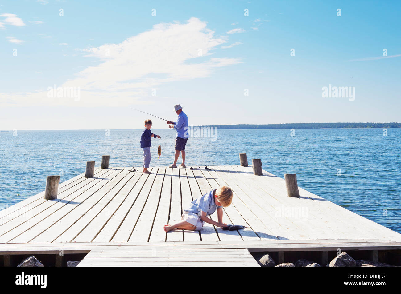 Grandfather and grandson fishing, Utvalnas, Sweden - Stock Image