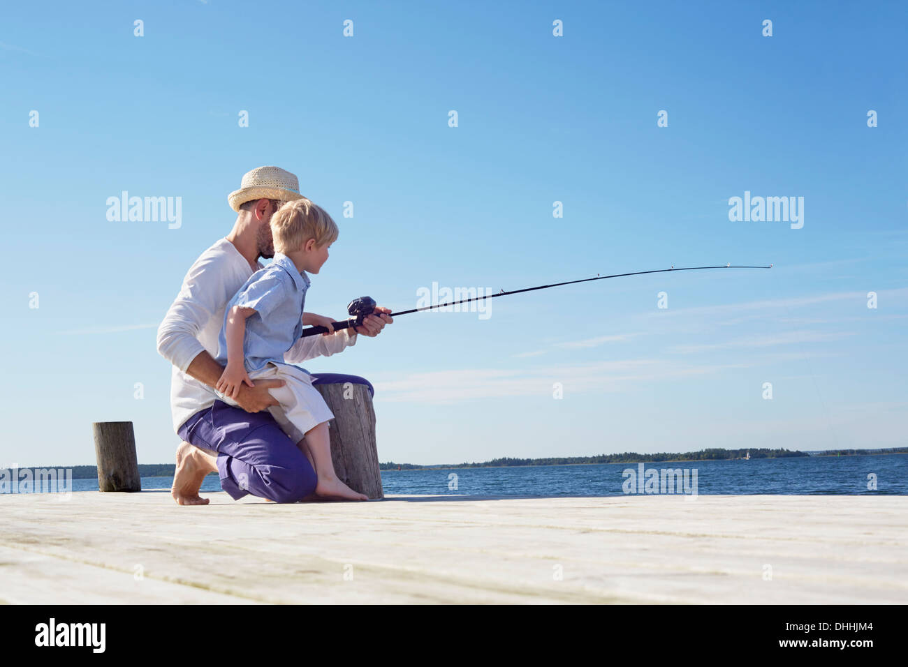 Father and son fishing, Utvalnas, Sweden - Stock Image
