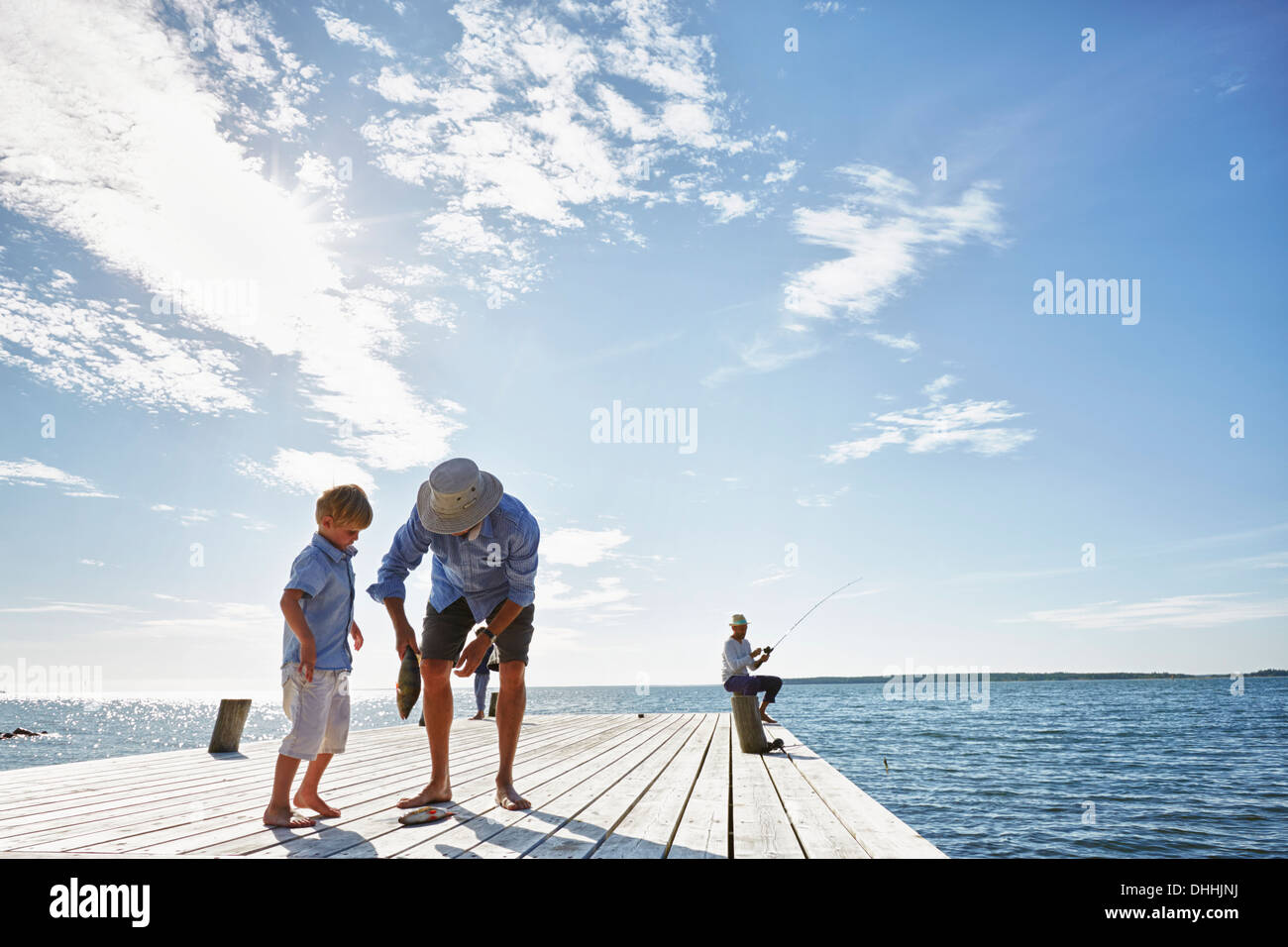 Grandfather and grandson with cuaght fish, Utvalnas, Sweden - Stock Image