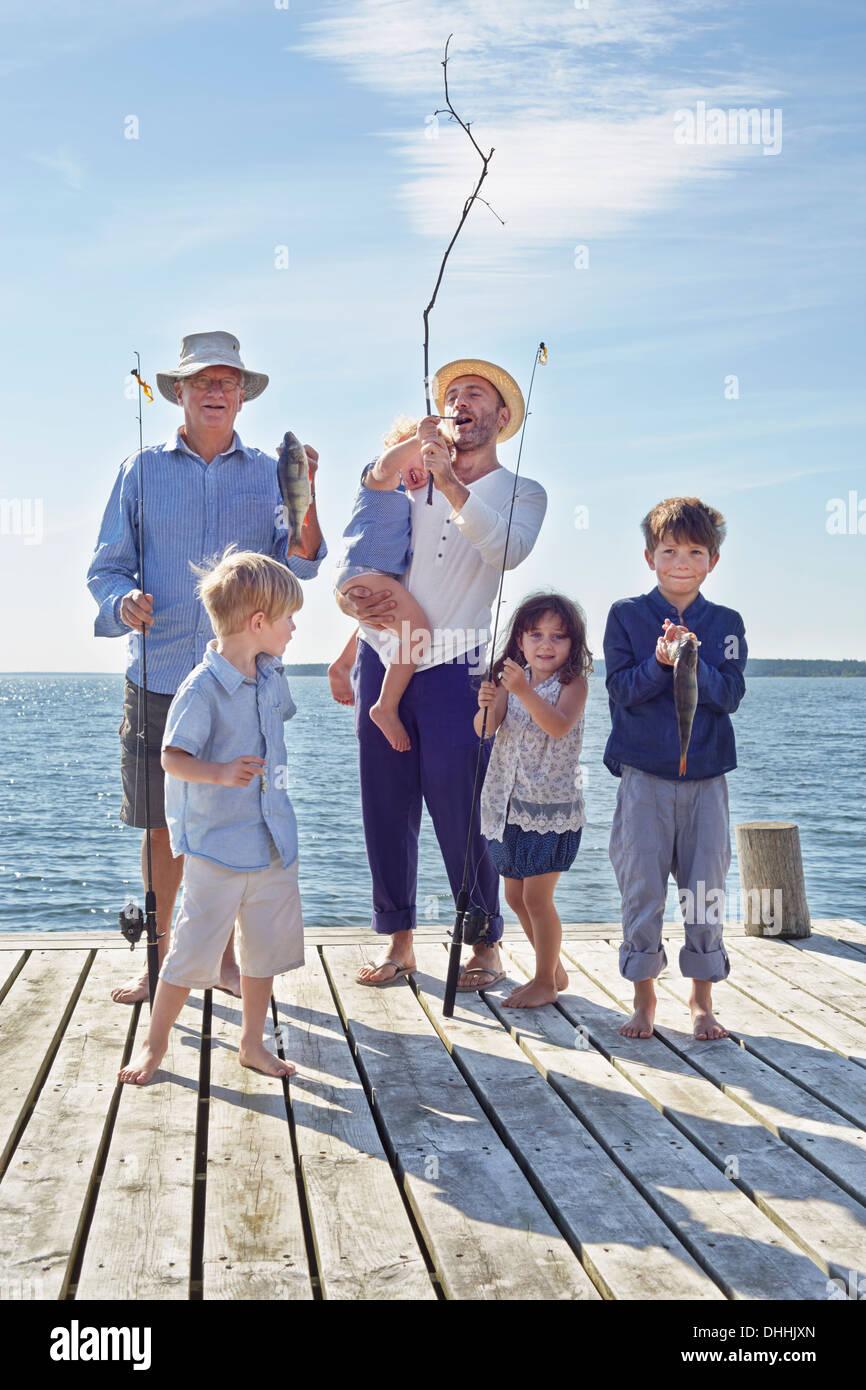 Three generation family on fishing trip, Utvalnas, Sweden Stock Photo