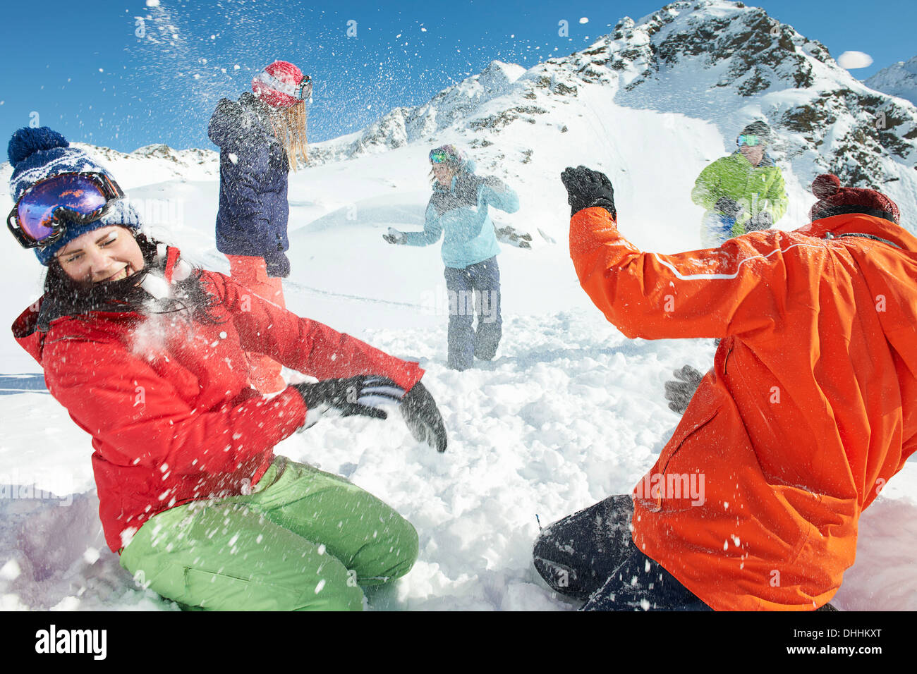 Friends having snowball fight, Kuhtai, Austria - Stock Image