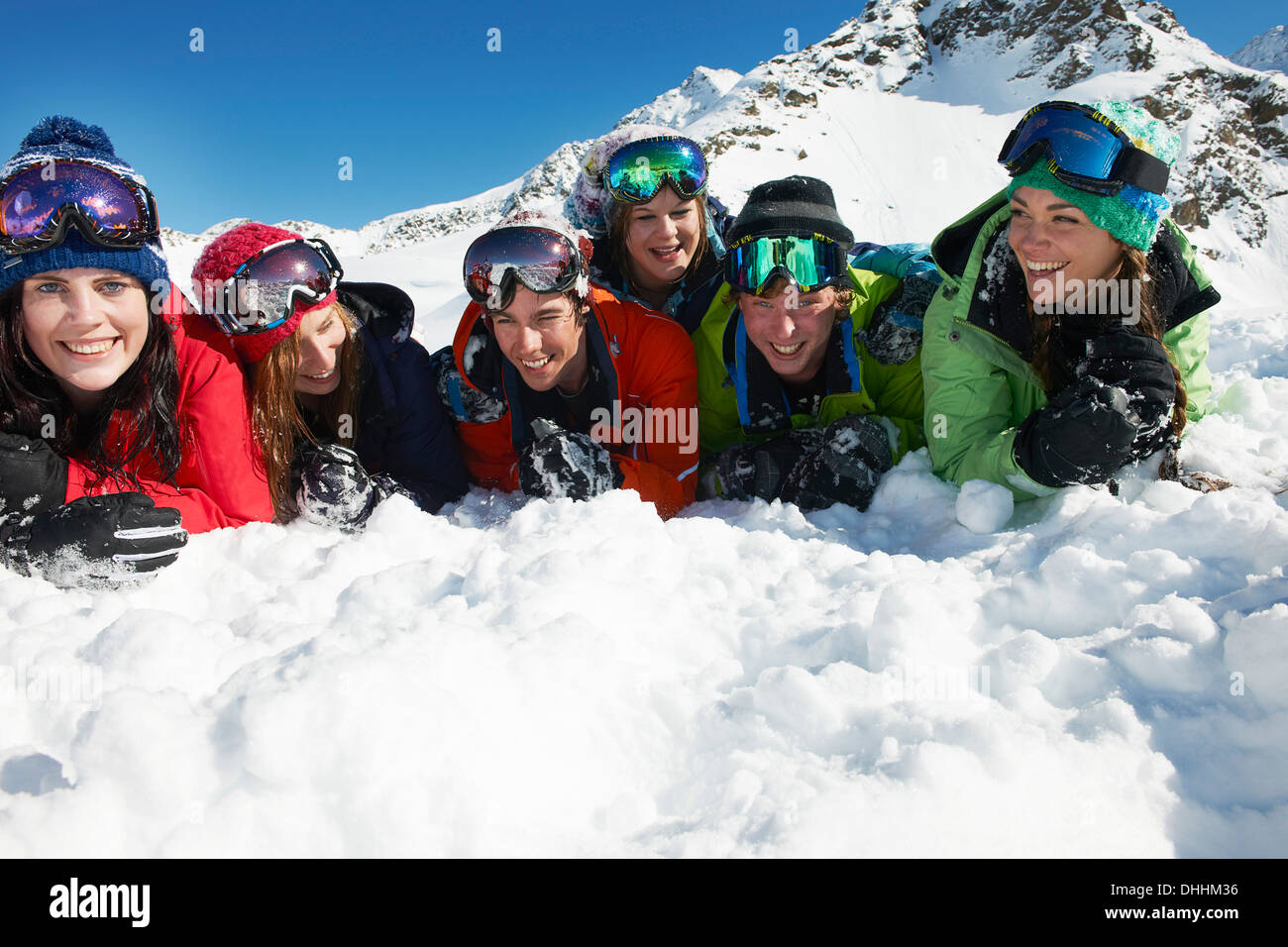 Friends lying on snow, Kuhtai, Austria - Stock Image