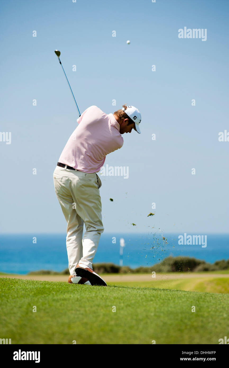 Golf player playing iron to green at golf course Navarino Dunes, Costa Navarino, Peloponnese, Greece, Europe - Stock Image