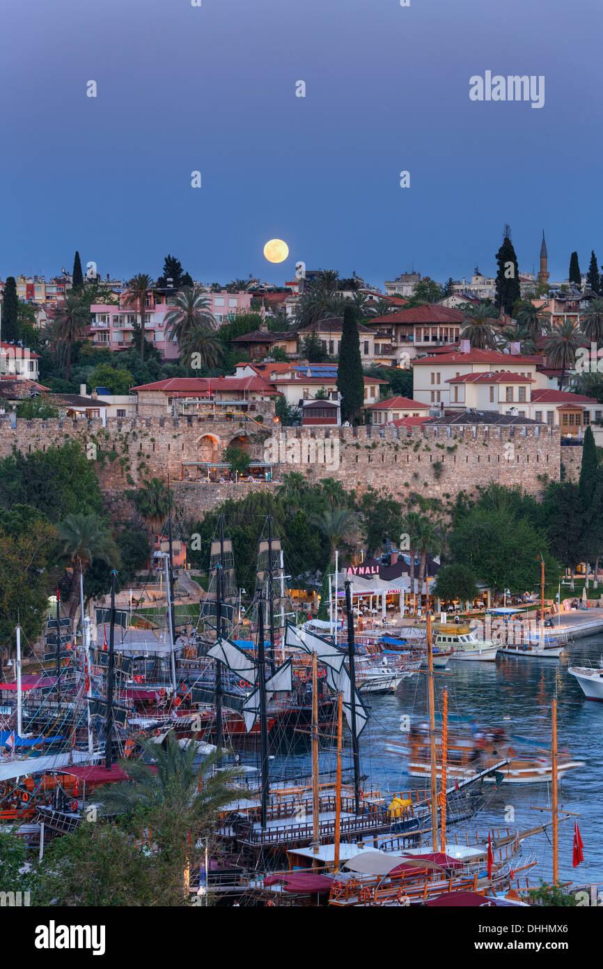 Moonrise over the harbour, Kaleiçi, Antalya, Antalya Province, Turkey - Stock Image