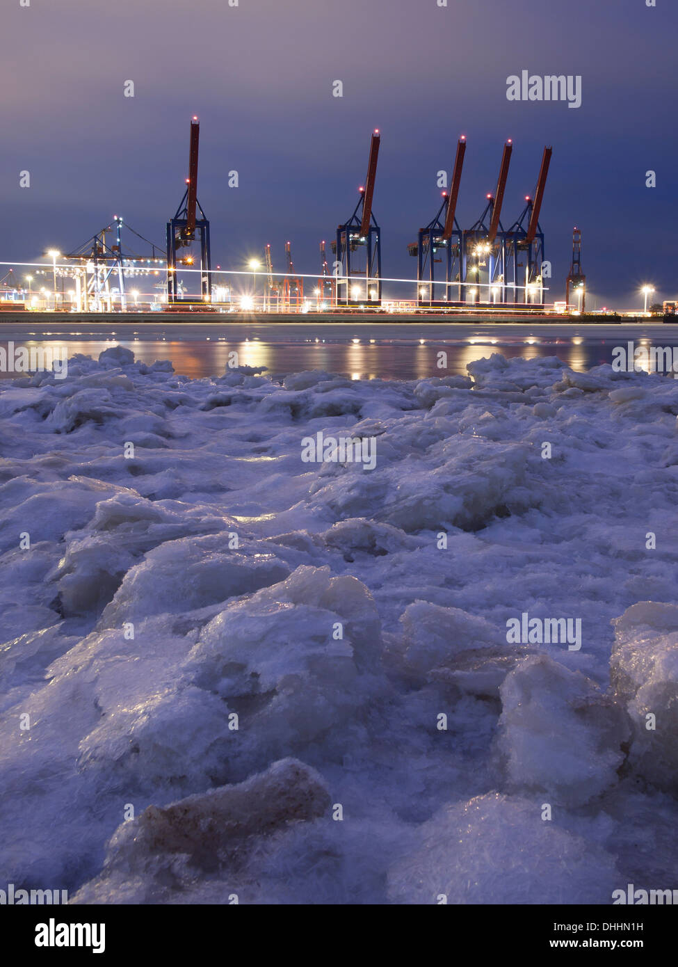 Frozen Elbe river with Waltershof container terminal in the evening, Hanseatic City of Hamburg, Germany, Europe - Stock Image