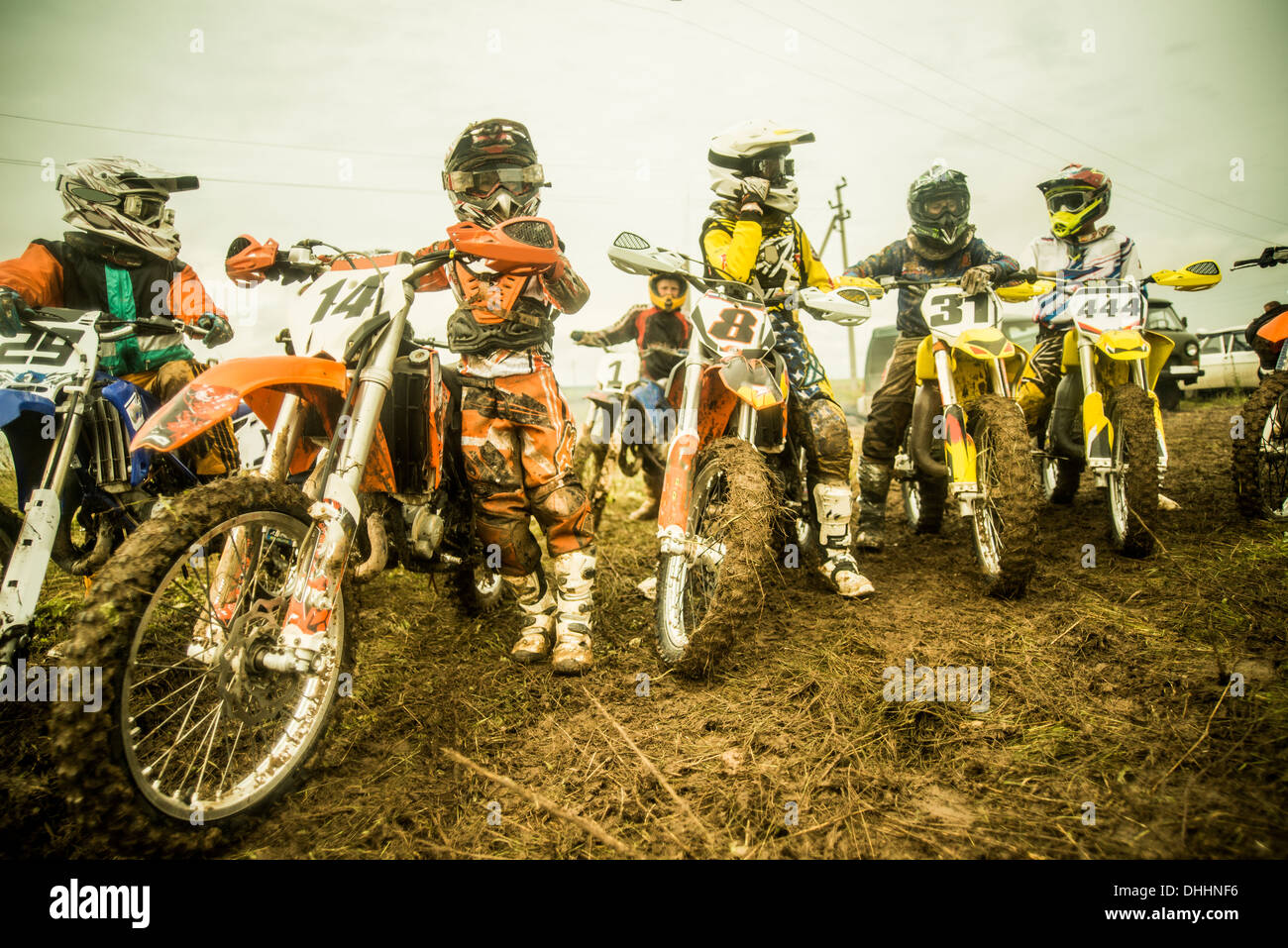 Group of boys on motorcycles at motocross - Stock Image