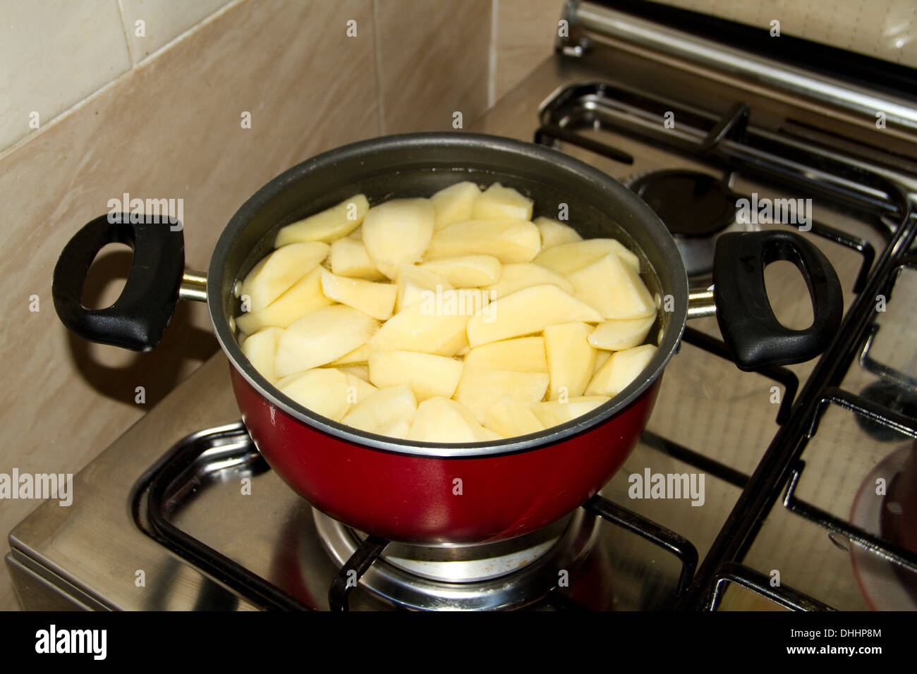Cooking Potatoes in Cooking Pot - Stock Image