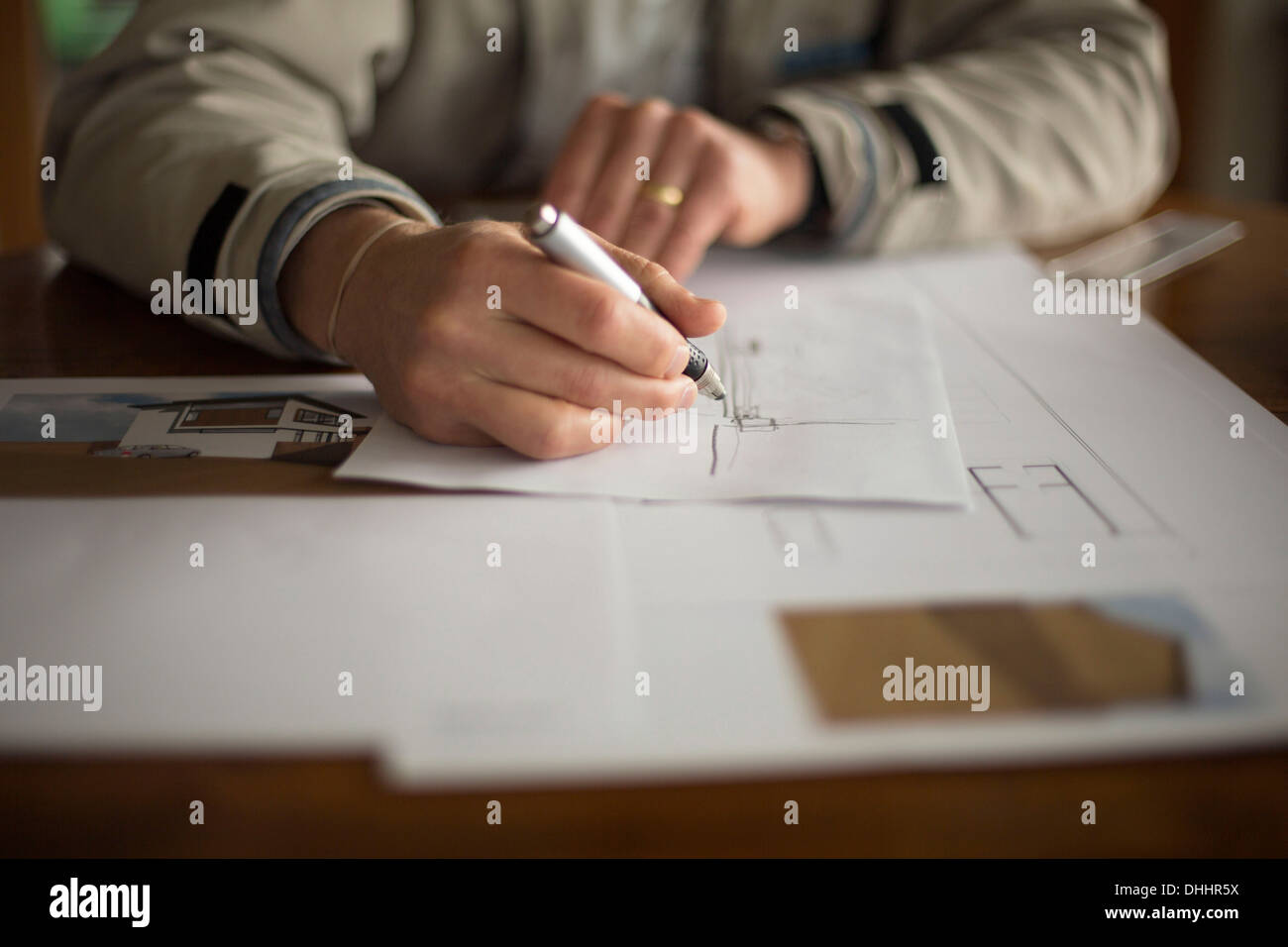Mid-section of man doing technical drawing - Stock Image
