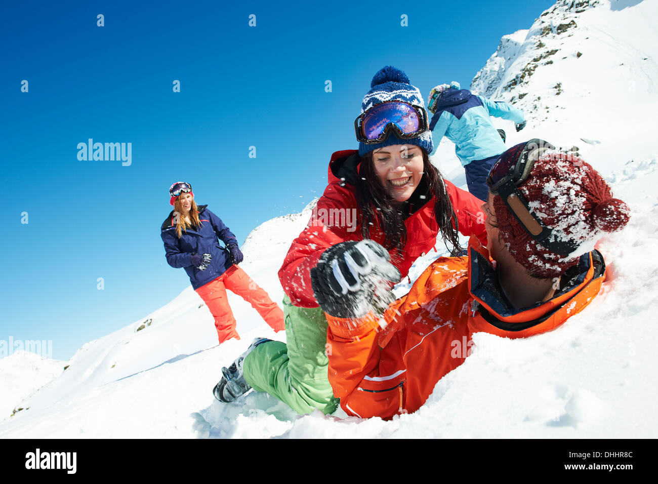 Friends play fighting in snow, Kuhtai, Austria - Stock Image