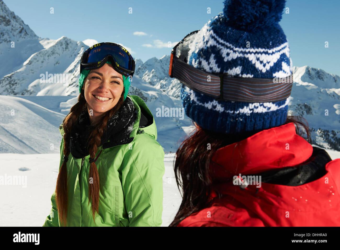 Two women wearing knit hats in snow, Kuhtai, Austria - Stock Image
