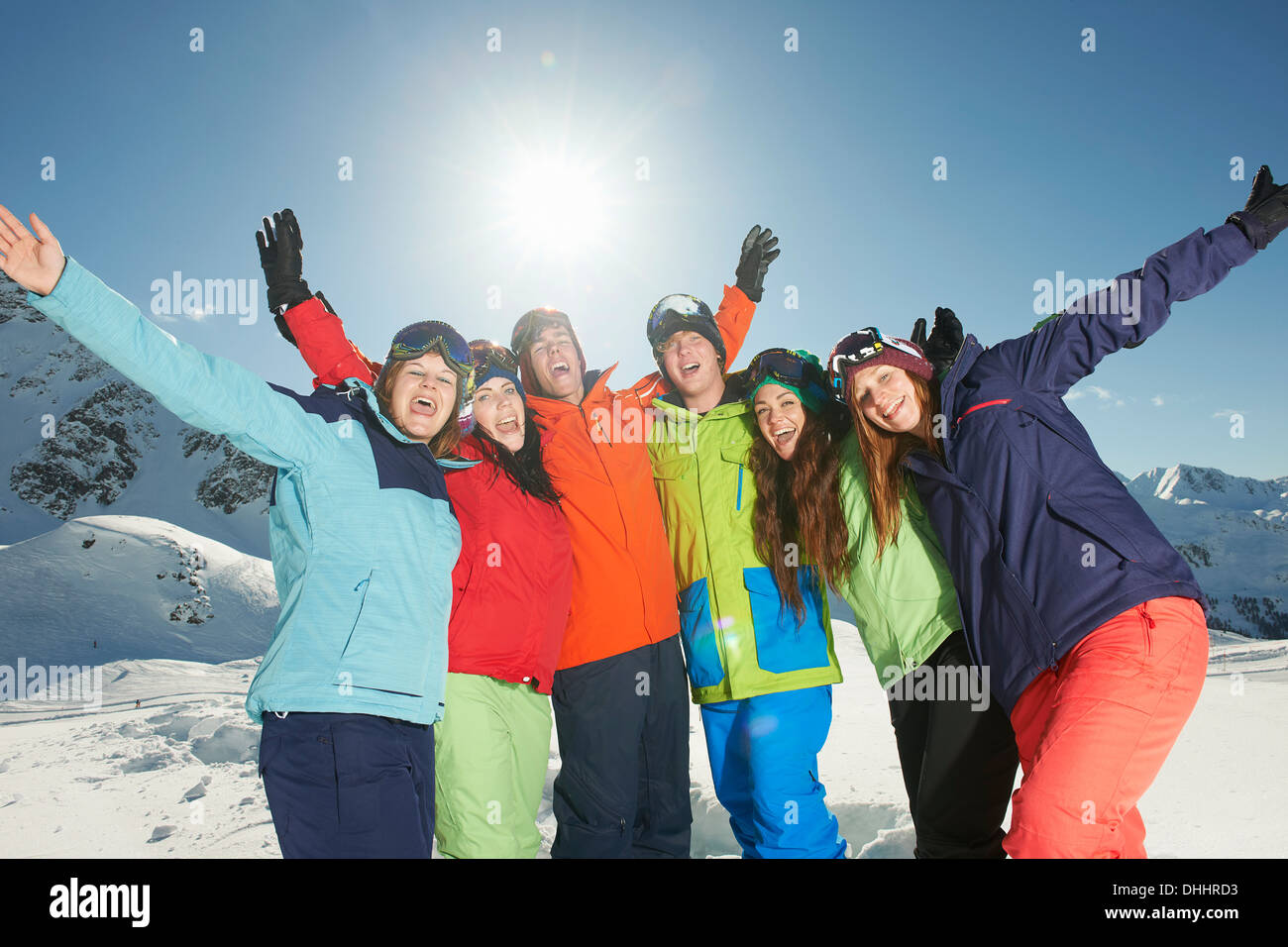 Friends smiling with arms raised, Kuhtai, Austria - Stock Image
