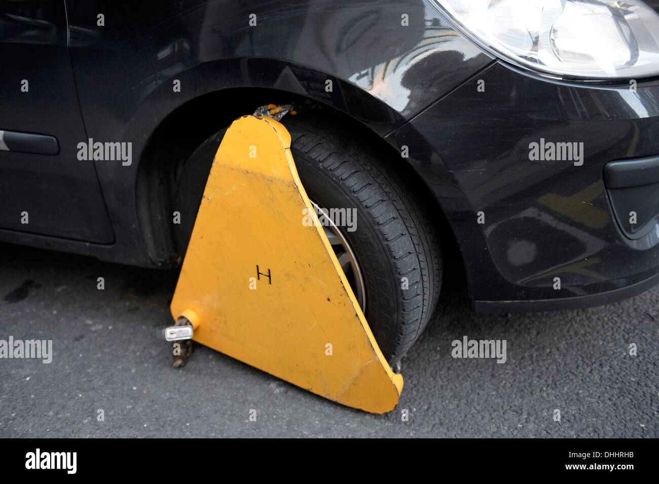 Immobilizer, wheel clamp on the wheel of a car parked in a