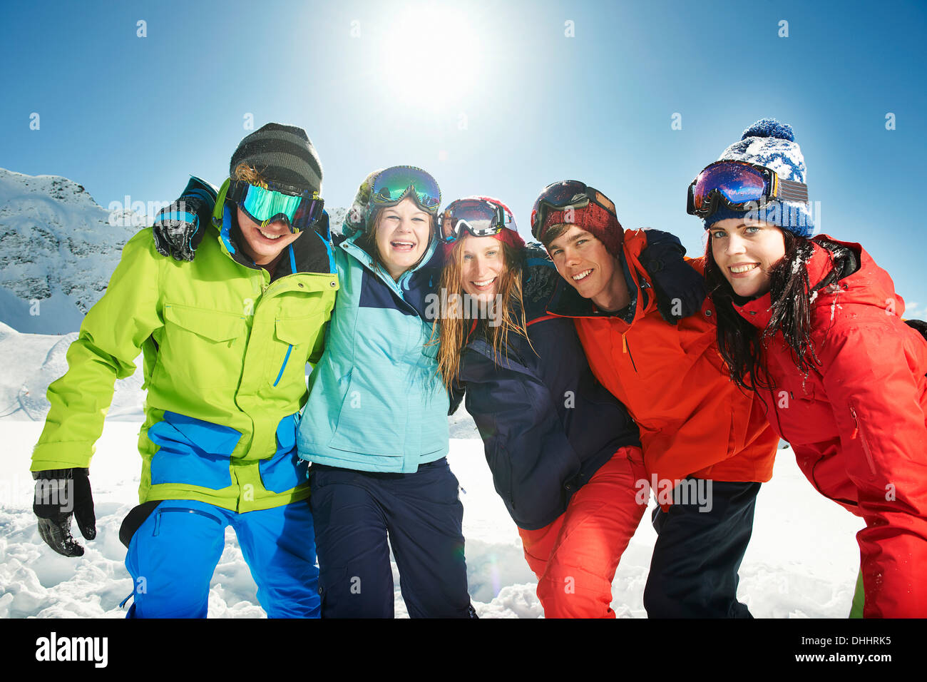 Friends wearing skiwear with arms around each other, Kuhtai, Austria - Stock Image
