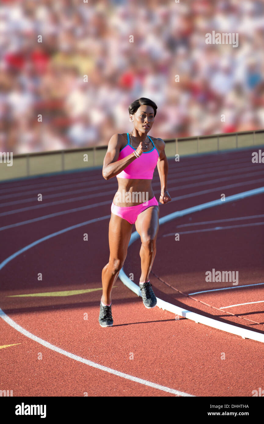 Runner racing on track - Stock Image