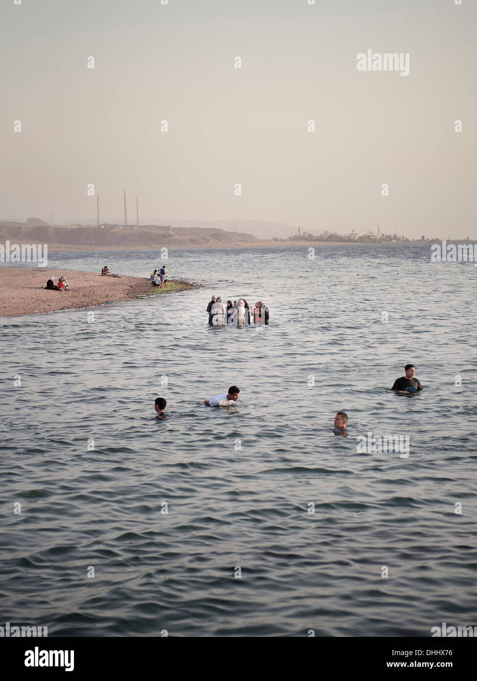 Group of muslim women and families bathing, Gulf of Aqaba, Red Sea, Jordan, Middle East, Asia - Stock Image
