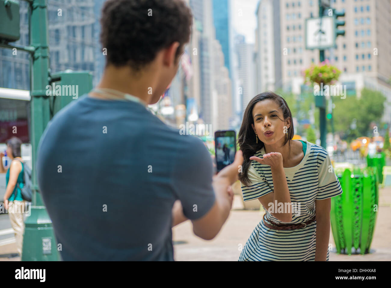 Woman blowing kiss - Stock Image