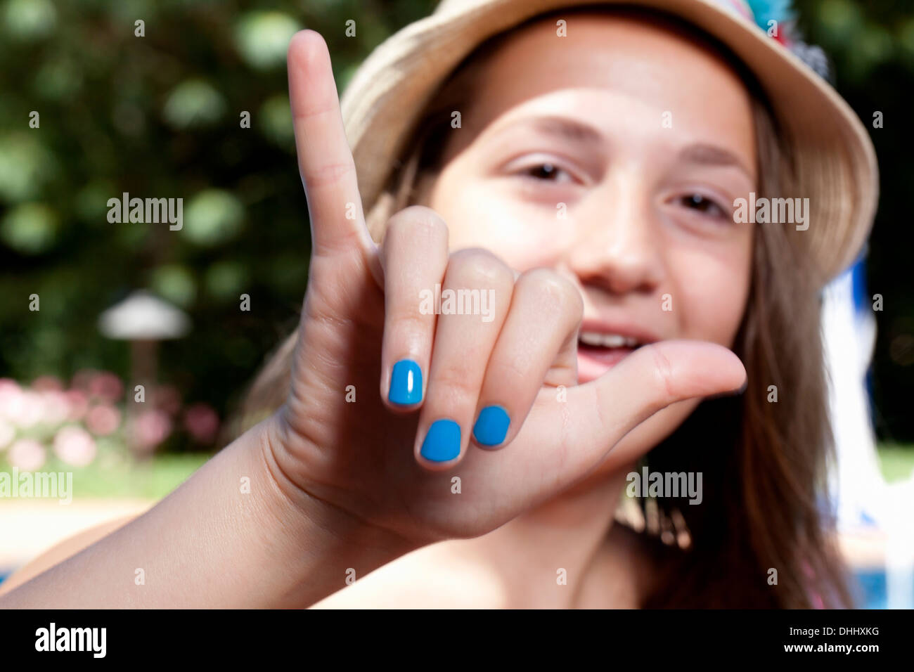 Girl with painted finger nails - Stock Image