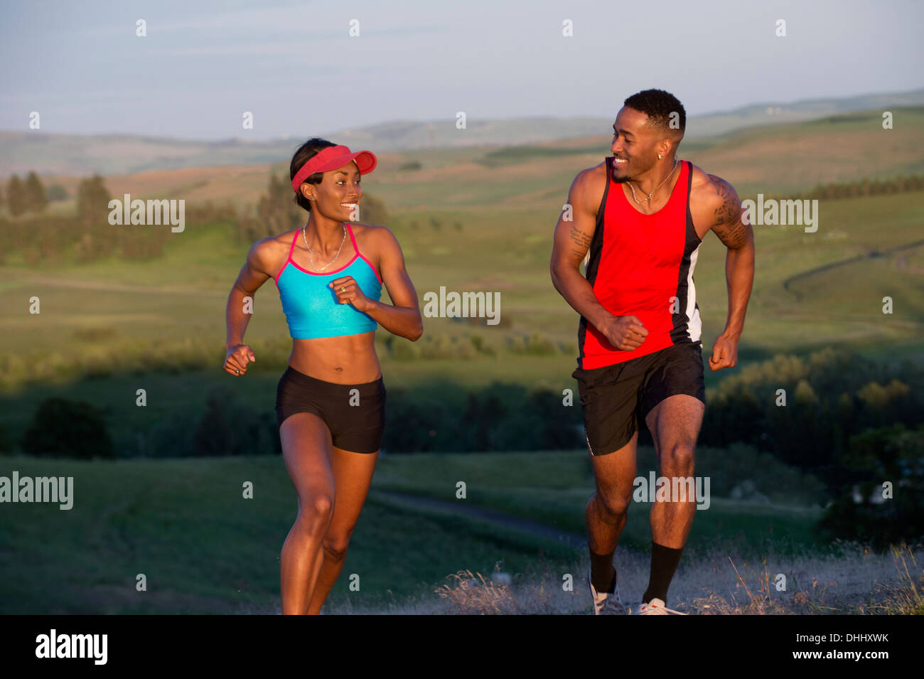 Young couple running in landscape, Othello, Washington, USA - Stock Image