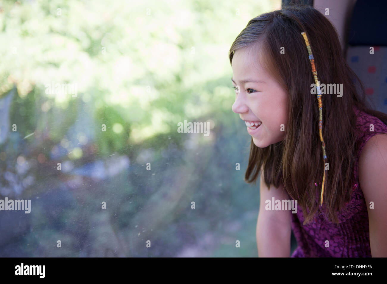 Girl looking out of train window - Stock Image