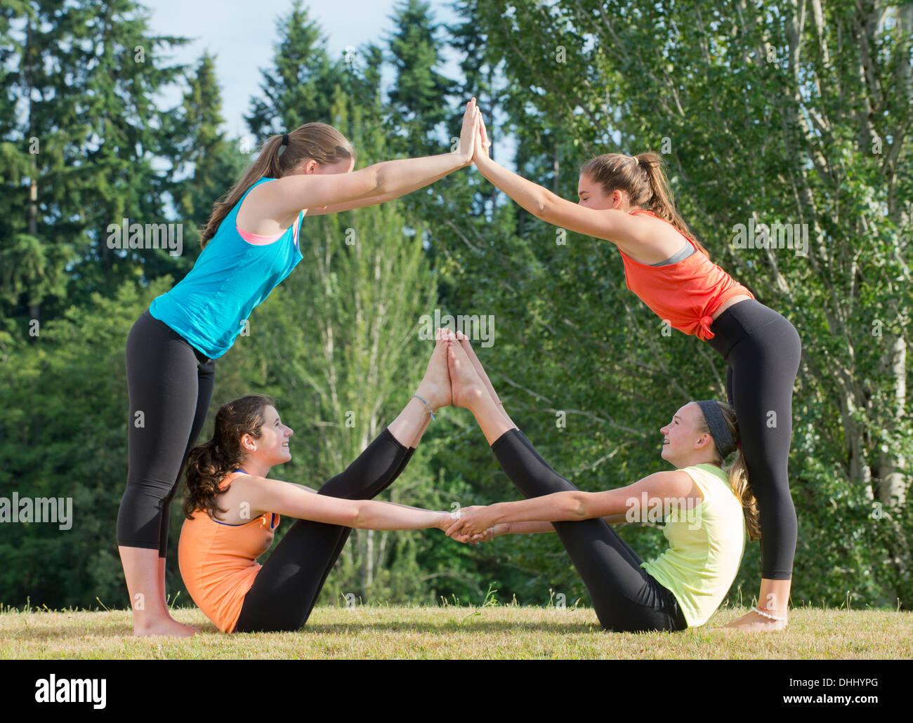 Teenage girls doing yoga Stock Photo - Alamy
