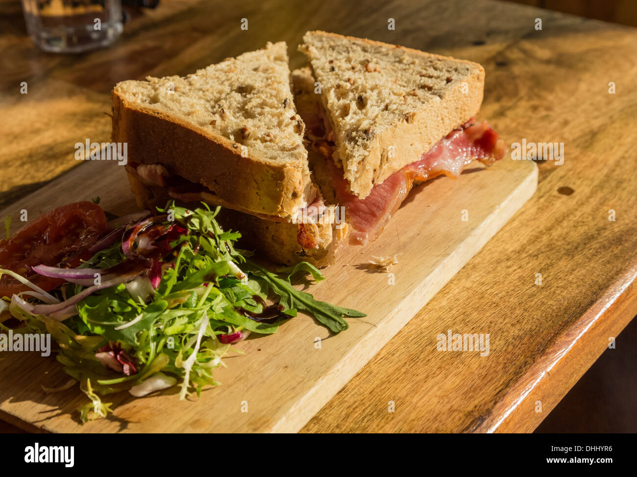 Bacon sandwich on thick wholemeal granary bread - Stock Image
