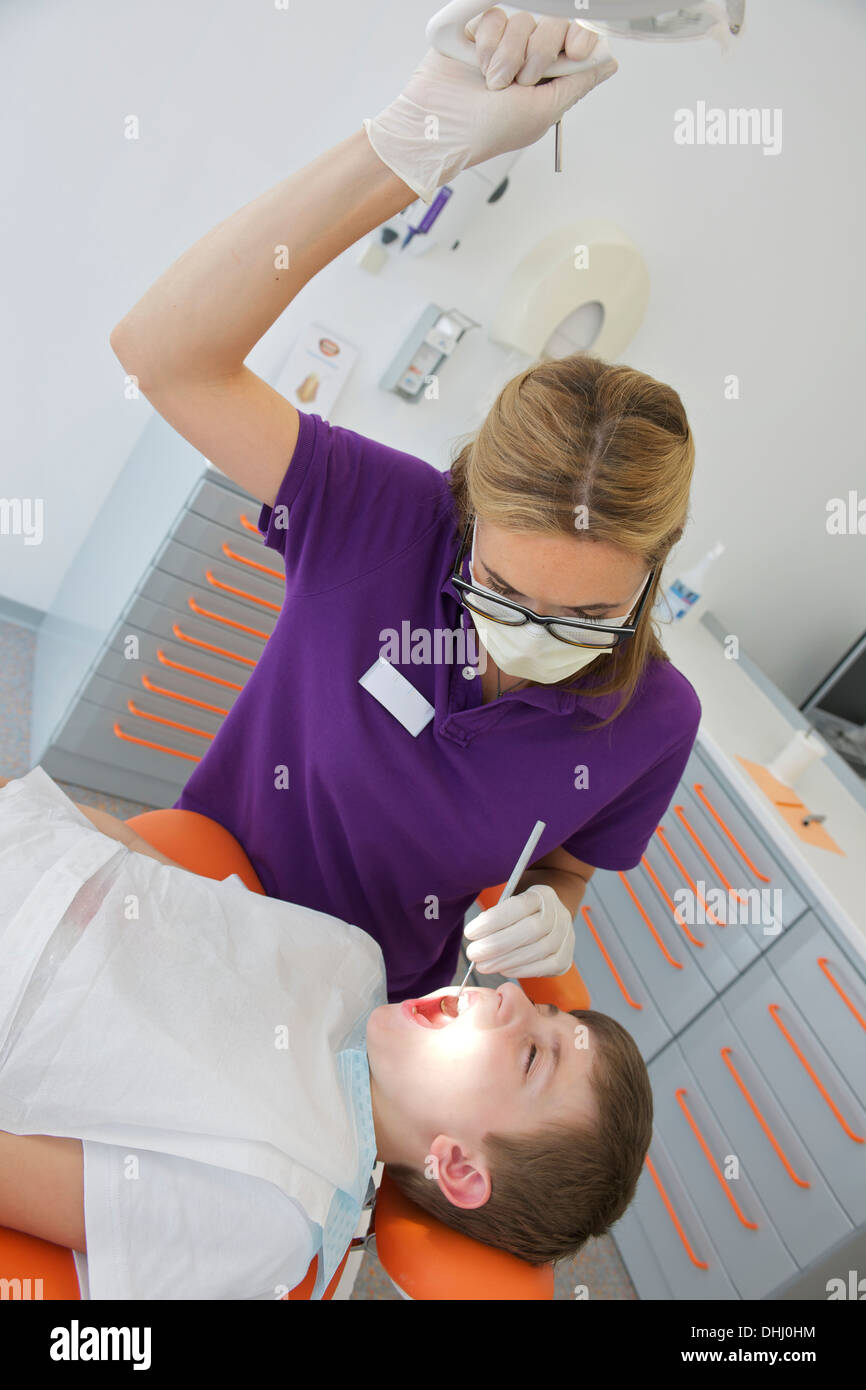 Dentist treating patient - Stock Image